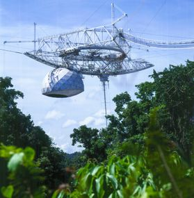 The Arecibo Observatory in Puerto Rico is recognized as one of the most important national centers for research in radio astronomy, planetary radar and atmospheric and space sciences. Photo credit: Courtesy of the Arecibo Observatory, a facility of the Na